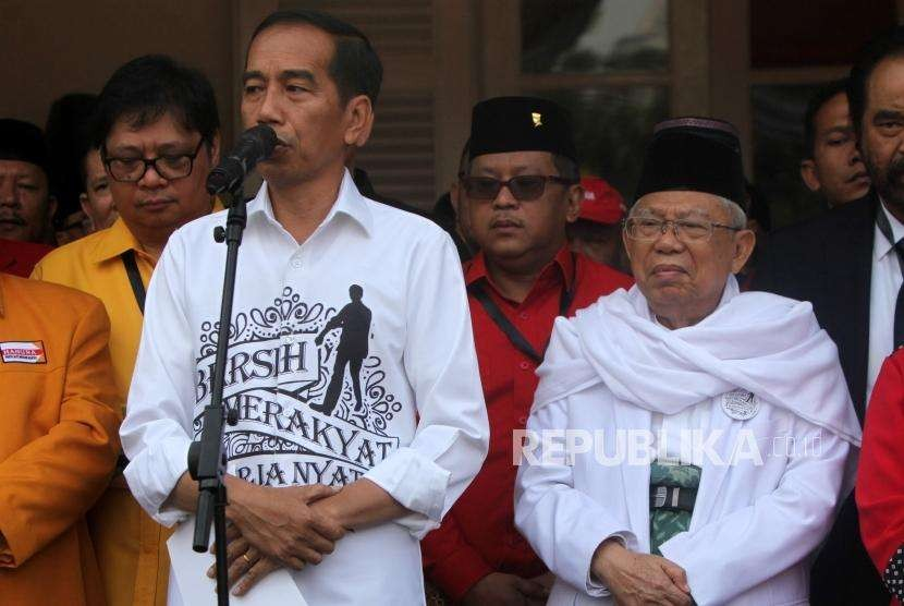 Incumbent President Joko Widodo (left) delivers his speech accompanied by his running mate KH Ma'ruf Amin (right) at historical building Gedung Joang, Jakarta, Friday (Aug 10).