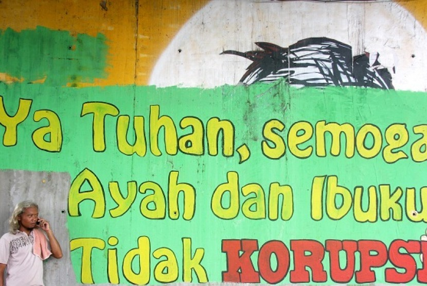 A mural with anti-corruption message is painted on the wall under the bridge in Jakarta. (illustration)
