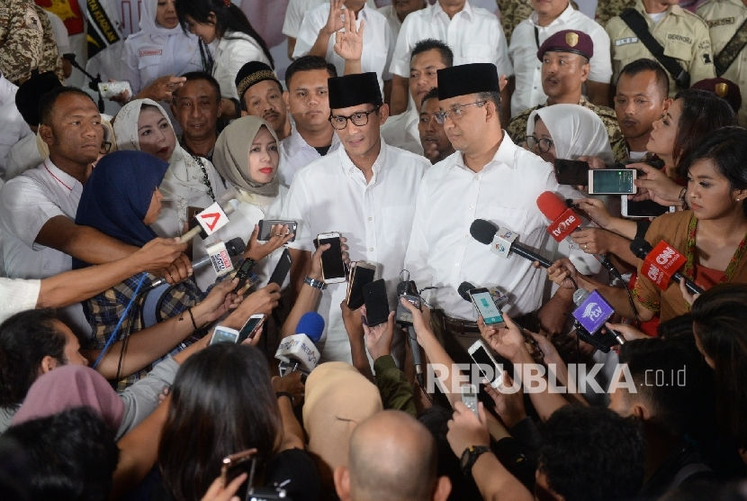 Candidate number three in Jakarta gubernatorial election, Anies Baswedan and Sandiaga Uno, held a press conference after becoming runner up in the race, Jakarta, Wednesday (Feb 15).