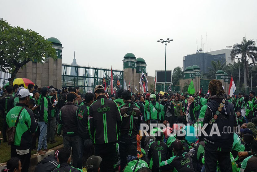 Ojek online drivers stage a demonstration in front of Parliament building, Jakarta, on Monday.