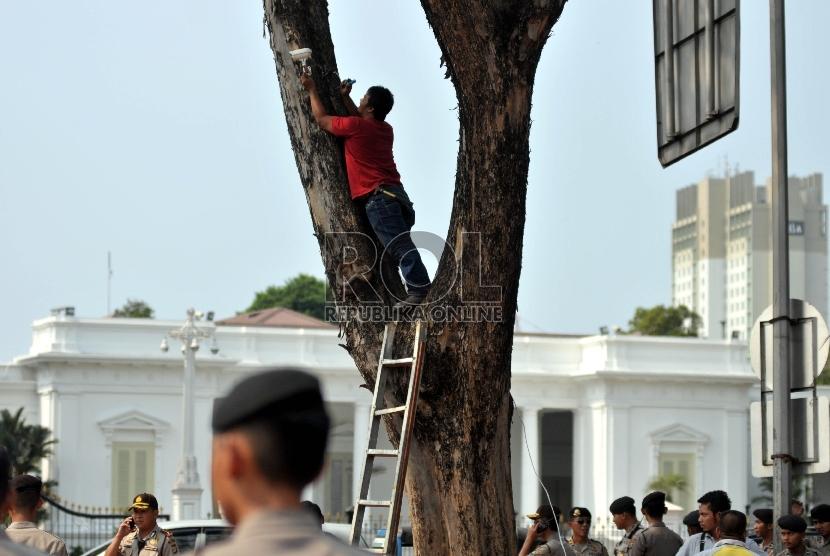 CCTV camera installed in front of State Palace, Jakarta.