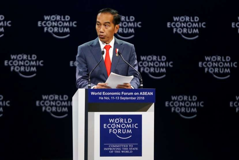 Indonesian President Joko Widodo delivers his speech at the plenary session of the World Economic Forum on ASEAN at Convention Center, Hanoi, Vietnam, Tuesday (Sept 12).