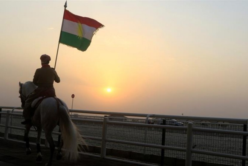 A Kurdish carried a flag to support referendum in Erbil, Iraq.