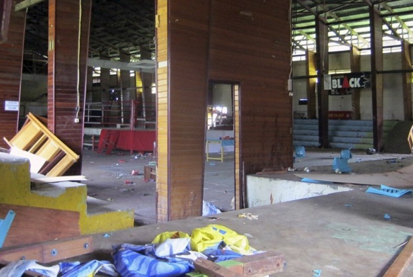 This photo shows the interior of a stadium where more than a dozen of people were killed in a stampede after spectators rioted to protest a local boxer's loss, in Nabire, Papua province, Indonesia, Monday, July 15, 2013.