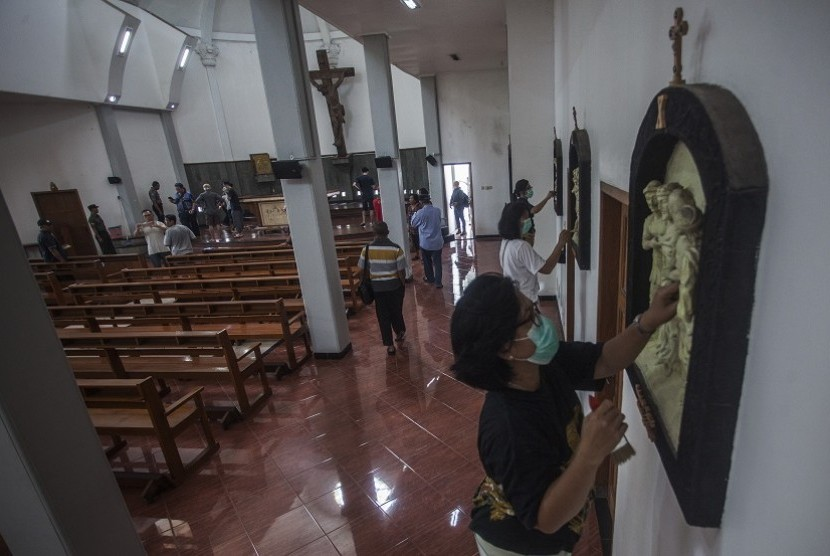 Residents clean up St Lidwina church following an attack by a man who trespassed while carrying a sword during Sunday (Feb 11) morning mass, in Bedog, Sleman, Yogyakarta on Monday (Feb 12).